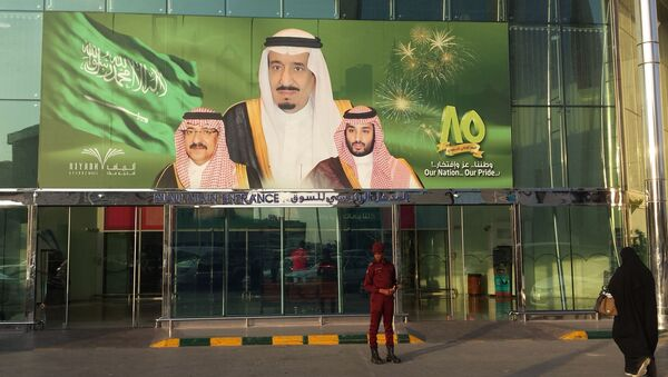 FILE -- In this Dec. 14, 2015 file photo, images of King Salman, center, Crown Prince Mohammed bin Nayef , left, and Deputy Crown Prince Mohammed bin Salman hang at the entrance of a shopping center in Riyadh, Saudi Arabia to mark the country's 85th anniversary - Sputnik International