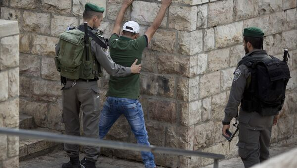 In this Friday, Oct. 23, 2015 file photo, an Israeli border police officer searches a Palestinian man at the Damascus Gate of Jerusalem's Old City ahead of Friday prayers - Sputnik International
