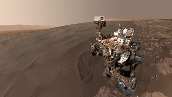 This Image obtained January 31, 2016 from NASA shows a self-portrait of NASA's Curiosity Mars rover vehicle at Namib Dune, where the rover's activities included scuffing into the dune with a wheel and scooping samples of sand for laboratory analysis. - Sputnik International
