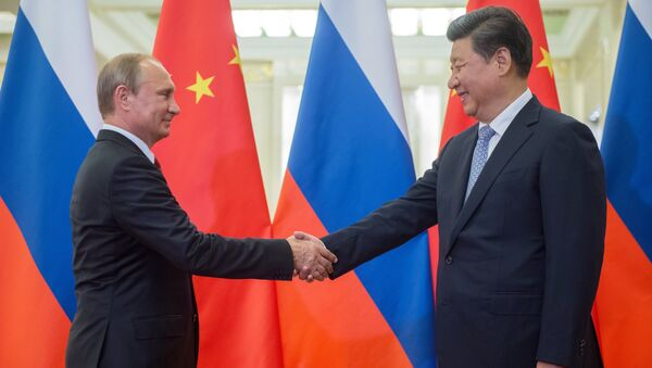 Russian President Vladimir Putin (left) and Chinese President Xi Jinping seen before the beginning of Russian-Chinese talks at the Great Hall of the People in Beijing, September 3, 2015 - Sputnik International