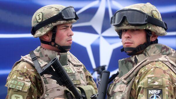 Georgian servicemen stand at the opening of a joint NATO-Georgia training center outside Tbilisi, Georgia, Thursday, Aug. 27, 2015 - Sputnik International