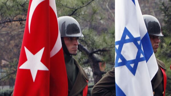 Turkish honour guard soldiers hold an Israeli, right, and Turkish flag, left, after Israeli Defense Minister Ehud Barak and his Turkish counterpart Vecdi Gonul reviewed the military guard of honour before their talks in Ankara, Turkey, Sunday, Jan. 17, 2010 - Sputnik International