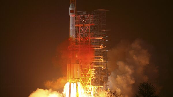 In this photo released by the Xinhua news agency, an orbiter is launched by a Long March-3III carrier rocket from the Xichang Satellite Launch Center in southwest China's Sichuan Province, on Sunday Jan. 17, 2010 - Sputnik International