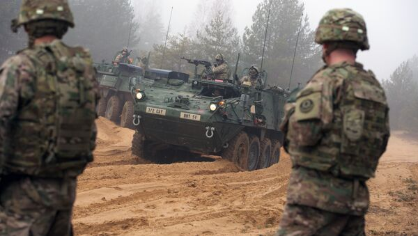 Picture taken on February 26, 2015 shows armored fighting vehicles IAV Stryker of the US Cavalry Regiment 2nd subdivision during training with Latvian an Canadian soldiers at the Adazi military training area in Latvia - Sputnik International