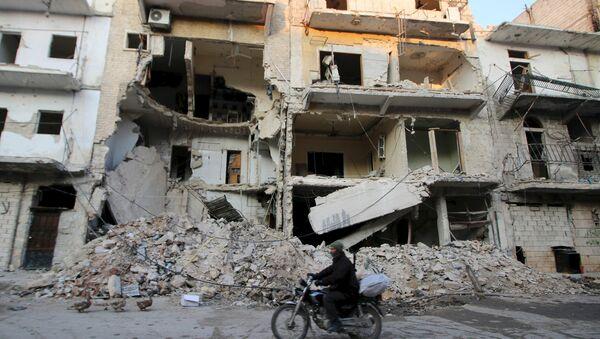 A man rides a motorcycle past damaged buildings in al-Myassar neighborhood of Aleppo, Syria January 31, 2016 - Sputnik International