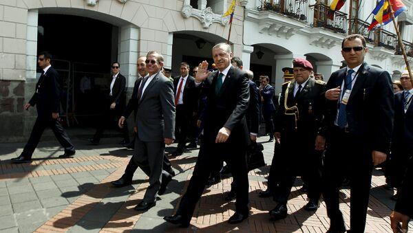 Turkish President Tayyip Erdogan waves next to Ecuador's Foreign Affairs Ricardo Patino while walking into Carondelet Palace in Quito, Ecuador, February 4, 2016 - Sputnik International