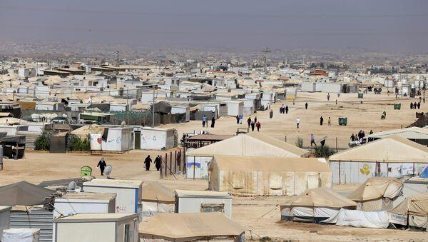 In this Wednesday, July 29, 2015 photo, Syrian refugees walk at Zaatari refugee camp, in Mafraq, Jordan - Sputnik International