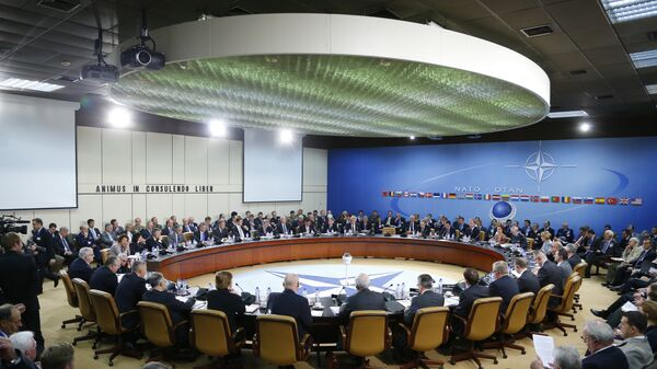 A general view of the table for a meeting of the NATO-Russia Council at the level of defense ministers at NATO headquarters in Brussels. File photo  - Sputnik International
