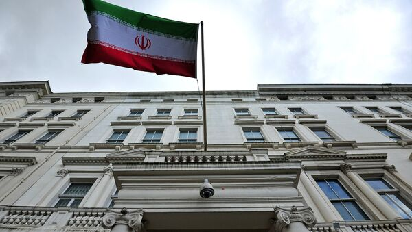The Iranian flag hangs outside the Iranian embassy in central London on February 20, 2014 - Sputnik International