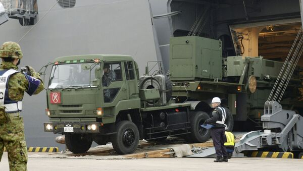 A Japanese Self-Defense Forces' vehicle carrying units of Patriot Advanced Capability-3 (PAC-3) missiles leaves a port on Japan's southern island of Ishigaki, Okinawa prefecture, in this photo taken by Kyodo February 6, 2016. - Sputnik International