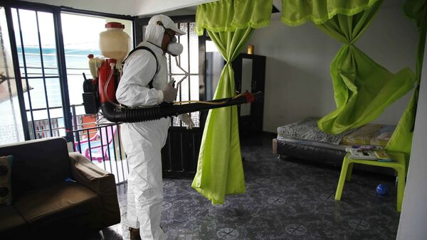 A health worker sprays insecticide inside the home of a woman diagnosed with the Zika virus in Acacias, Colombia - Sputnik International