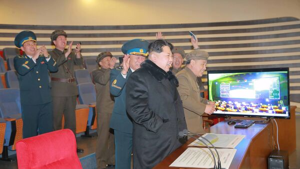 North Korean leader Kim Jong-un reacts as he watches a long range rocket launch in this undated photo released by North Korea's Korean Central News Agency (KCNA) in Pyongyang February 7, 2016. - Sputnik International