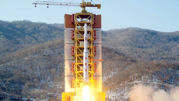 A North Korean long-range rocket is launched into the air at the Sohae rocket launch site, North Korea - Sputnik International