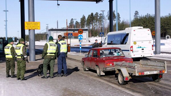 Picture taken 09 March 2005 shows a Russian registered car arriving at customs at the Pelkola international Border and Customs Station in Imatra, south-east Finland on the Finnish-Russian border - Sputnik International