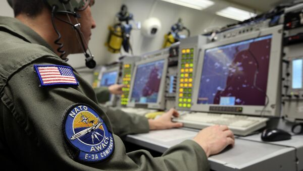 A controller monitors is seen screening aboard a NATO AWACS (Airborne Warning and Control Systems) aircraft during a surveillance flight over Romania in this April 16, 2014. - Sputnik International