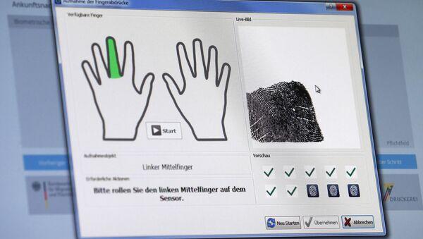 A fingerprint of a refugee is seen on a computer screen at the migrants registration center of the Patrick-Henry Village refugee center in Heidelberg, Germany January 28, 2016. - Sputnik International