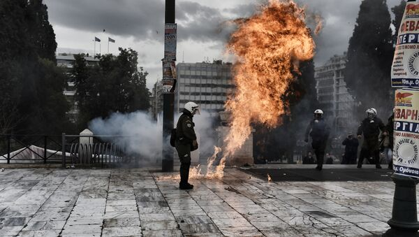 A firebomb explodes beside a riot police member during a massive protest in Athens on February 4, 2016. - Sputnik International