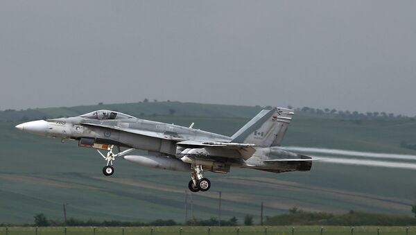 This file photo taken on May 28, 2014 shows a fighter type F-18 Hornet of the Canadian Royal Air Force taking off from the military airbase at Campia Turzii. Canada will end air strikes targeting the Islamic State group in Iraq and Syria and bring home its six fighter jets on February 22, the government announced February 8, 2016 - Sputnik International