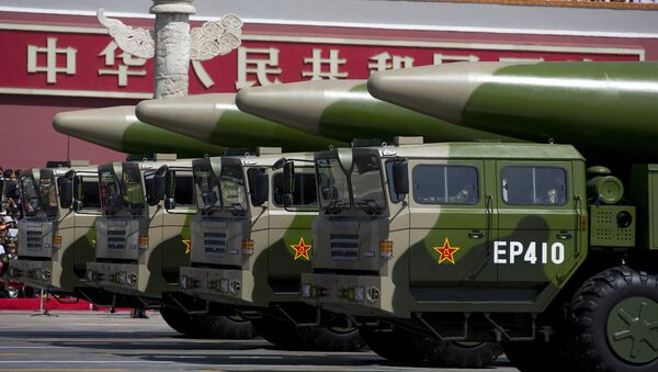 Military vehicles carrying DF-26 ballistic missiles drive past Tiananmen Gate during a military parade at Tiananmen Square in Beijing on September 3, 2015, to mark the 70th anniversary of victory over Japan and the end of World War II - Sputnik International