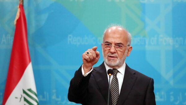 Iraqi Foreign Minister Ibrahim al-Jaafari speaks during a news conference in Baghdad, Iraq, Wednesday, Dec. 30, 2015 - Sputnik International
