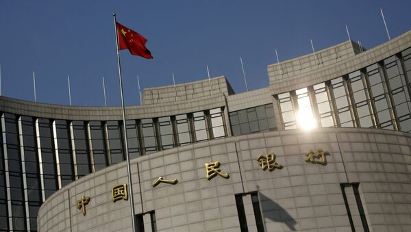 A Chinese national flag flies at the headquarters of the People's Bank of China, the country's central bank, in Beijing, China, January 19, 2016 - Sputnik International