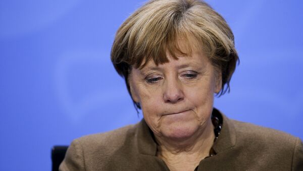 German Chancellor Angela Merkel reacts as she addresses a news conference after a meeting with state premiers at the Chancellery in Berlin, Germany, January 28, 2016 - Sputnik International