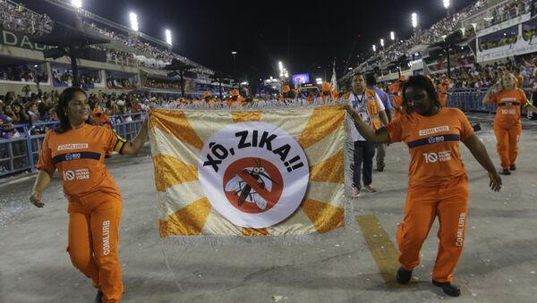 Workers holds a flag that reads in portugues Out Zika as part of a campaign to warn people about the spread of the Zika virus during carnival celebrations at the Sambadrome in Rio de Janeiro, Brazil, Monday, Feb. 8, 2016 - Sputnik International