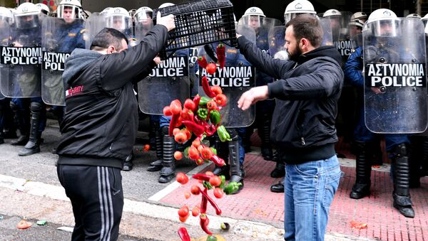 Farmers throw vegetables in front of the Agriculture ministry in Athens during a demonstration of farmers against the pension reform on February 12, 2016. - Sputnik International
