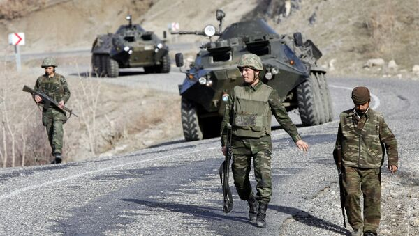 Turkish soldiers patrol a road near the Turkey-Iraq border in the mainly Kurdish southeastern province of Sirnak (File) - Sputnik International