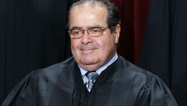 U.S. Supreme Court Justice Antonin Scalia is seen during a group portrait in the East Conference Room at the Supreme Court Building in Washington, in this file photo taken October 8, 2010. - Sputnik International