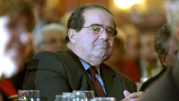 U.S. Supreme Court Justice Antonin Scalia sits in the audience at a National Italian American Foundation event in Washington, in this file photo taken October 20, 2006. - Sputnik International