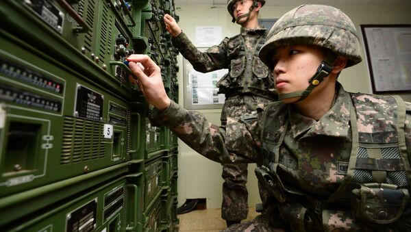 South Korean army soldiers adjust equipment used for propaganda broadcasts near the border area between South Korea and North Korea in Yeoncheon, South Korea, Friday, Jan. 8, 2016 - Sputnik International