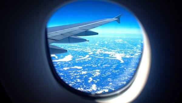 Airplane window - Sputnik International