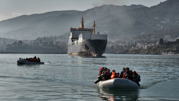 Refugees and migrants arrive on a dinghy at the port of Mytilene, on the Greek island of Lesbos, after crossing the Aegean sea from Turkey, on February 18, 2016 - Sputnik International