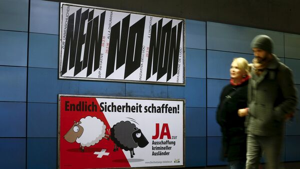 A poster of Swiss People's Party (SVP), demanding to vote for an initiative to deport criminal foreigners, is placed underneath another one against it at the central railway station in Zurich, Switzerland February 12, 2016 - Sputnik International