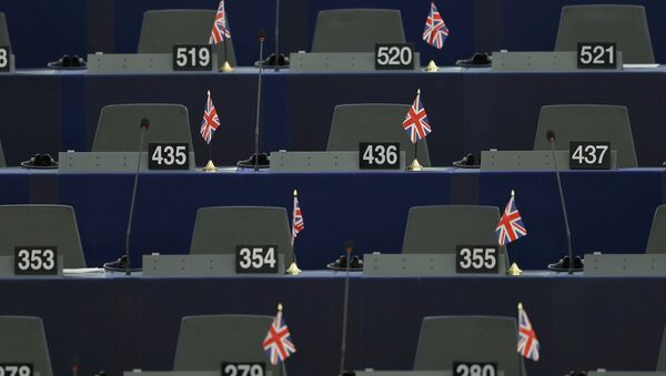 British Union Jack flags are seen on the desks of members of the European parliament ahead of a debate on the upcoming summit and EU referendum in the UK, in Strasbourg, France, February 3, 2016. - Sputnik International