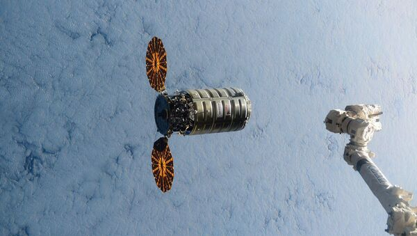 This image made available by NASA via Twitter shows the Cygnus spacecraft approaching the International Space Station on Wednesday, Dec. 9, 2015 - Sputnik International