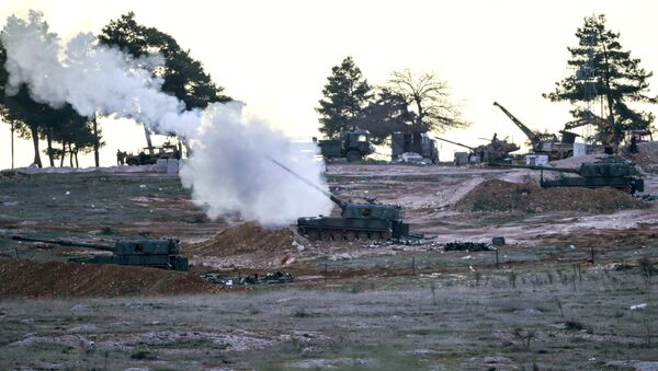 Tanks stationed at a Turkish army position near the Oncupinar crossing gate close to the town of Kilis, south central Turkey, fire towards the Syria border, on February 16, 2016 - Sputnik International