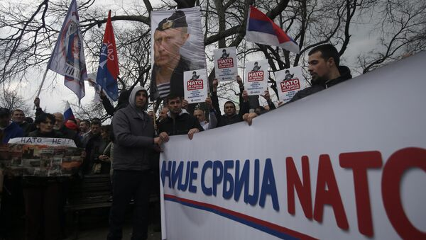 Protesters holding a banner that reads: Serbia is not NATO during a protest against NATO in downtown Belgrade, Serbia, Saturday, Feb. 20, 2016 - Sputnik International