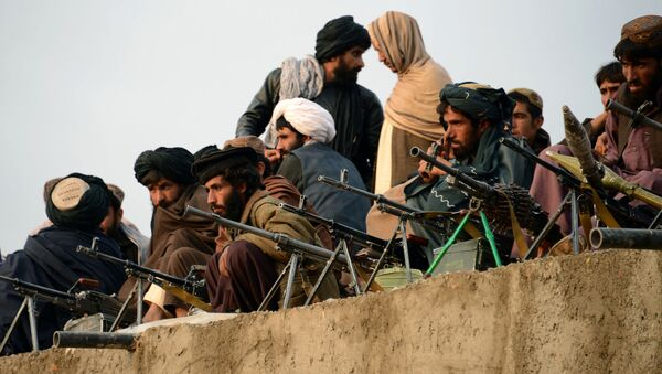 In this photograph taken on November 3, 2015, Afghan Taliban fighters listen to Mullah Mohammad Rasool Akhund (unseen), the newly appointed leader of a breakaway faction of the Taliban, at Bakwah in the western province of Farah - Sputnik International