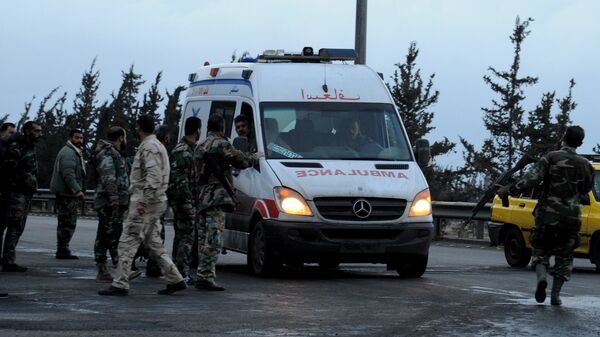 A Syrian red crescent ambulance arrives to evacuate wounded from the area of the Sayyida Zeinab shrine south of Syria's capital Damascus on February 21, 2016, after a series of attacks, targetted the Shiite shrine area - Sputnik International