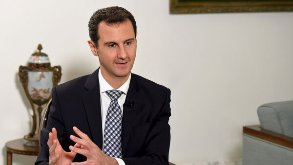 Syria's President Bashar al-Assad speaks during an interview with Spanish newspaper El Pais in Damascus, in this handout picture provided by SANA on February 20, 2016 - Sputnik International