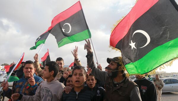 Libyans wave their national flags as they celebrate Libya's eastern government's gains in the area, in Benghazi, Libya, February 24, 2016. - Sputnik International