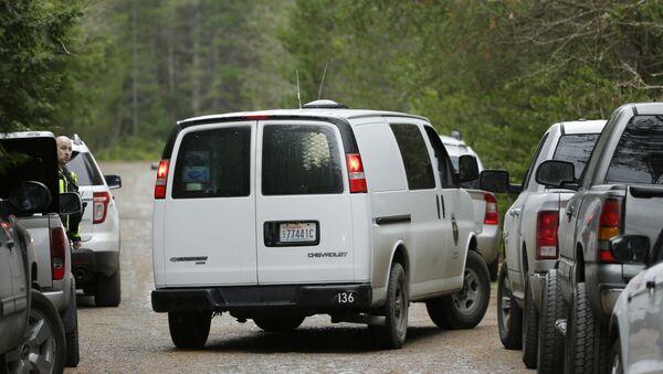 A Mason County Coroner's van arrives at the scene of a fatal shooting Friday, Feb. 26, 2016, near Belfair, Wash. - Sputnik International