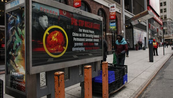 A poster ad that reads : DPRK: STOP NUCLEAR GAMBLE! is displayed on a street near Times Square in New York on February 9,2016 - Sputnik International