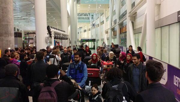 First Syrian Refugee family landed in Toronto - Sputnik International