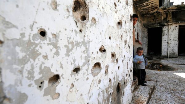 In this picture taken Friday, Feb. 26, 2016, Syrian boys are seen inside their destroyed house at neighborhood of Baba Amr in Homs, Syria - Sputnik International