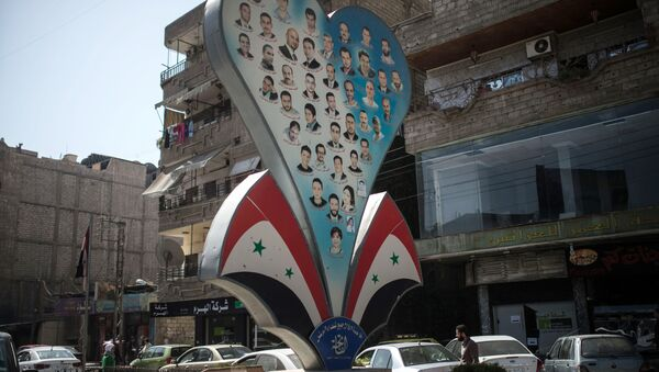 Photos of deceased residents of Damascus on a street of the city - Sputnik International