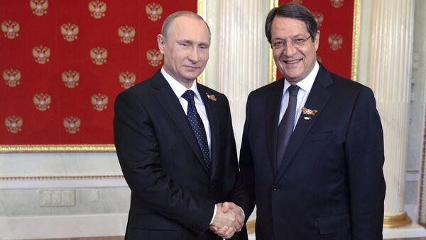 President Vladimir Putin, left, and President of Cyprus Nicos Anastasiades during the welcome reception for foreign delegation heads and honorary guests in the Kremlin (File) - Sputnik International