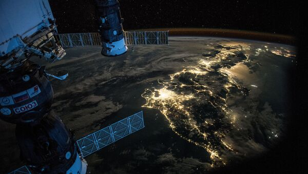 Night Earth observation of Japan taken by Expedition 44 crewmember Scott Kelly, with a Soyuz Spacecraft connected to the Mini Research Module 1 (MRM1), and a Progress Spacecraft visible - Sputnik International